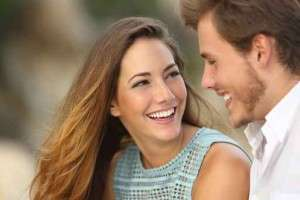 young couple laughing with a white perfect smile
